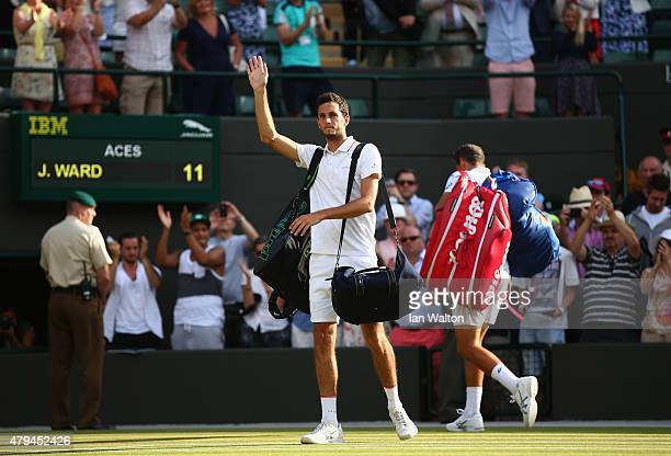 James Ward of Great Britain leaves court one after losing his Mens Singles Third Round match against Vasek Pospisil of Canada during day six of the...