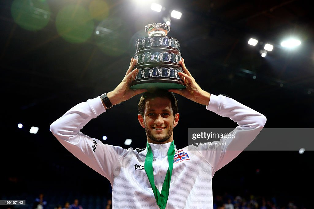 James Ward of Great Britain lifts his trophy following their victory during day three of the Davis Cup Final match between Belgium and Great Britain at Flanders Expo on November 29, 2015 in Ghent, Belgium.