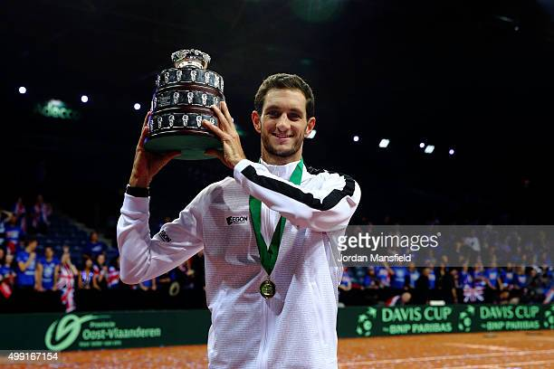 James Ward of Great Britain lifts his trophy following their victory during day three of the Davis Cup Final match between Belgium and Great Britain...