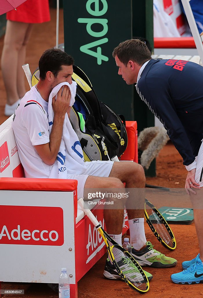 James Ward of Great Britain listens to advice from his team captain Leon Smith during the fifth and decisive rubber against Andreas Seppi of Italy during day three of the Davis Cup World Group Quarter Final match between Italy and Great Britain at Tennis Club Napoli on April 6, 2014 in Naples, Italy.