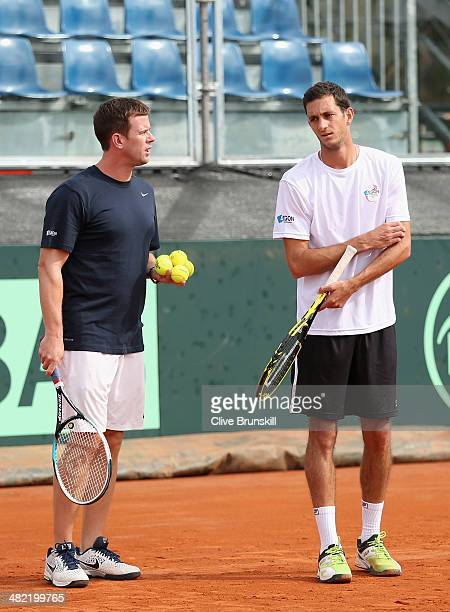 James Ward of Great Britain listens to coaching advice from his team captain Leon Smith during a practice session prior to the Davis Cup World Group...