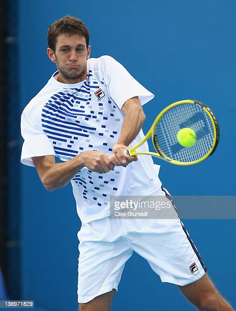 James Ward of Great Britain plays a backhand during his straightsets victory in his thirdround qualifying match against Igor Sijsling of Netherlands...