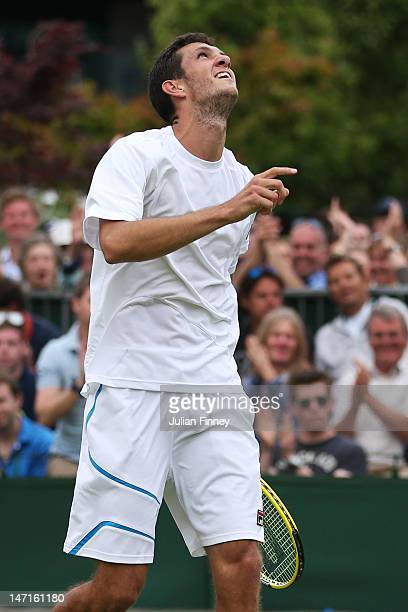 James Ward of Great Britain reacts after winning his Gentlemen's Singles first round match against Pablo Andujar of Spain on day two of the Wimbledon...