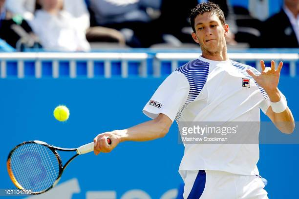 James Ward of Great Britain returns a shot to Feliciano Lopez of Spain during the AEGON International at Devonshire Park on June 15 2010 in...