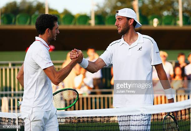 James Ward of Great Britain shakes hands with his opponent after winning his Gentlemens Singles first round match against Luca Vanni of Italy during...