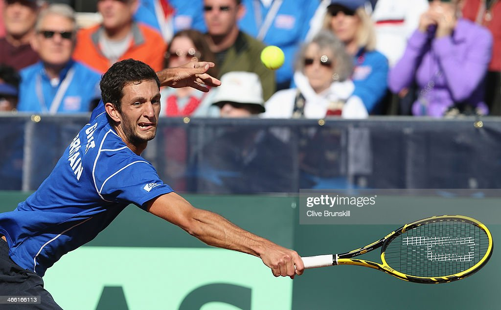 James Ward of Great Britain stretches to play a backhand against Sam Querrey of the United States during day one of the Davis Cup World Group first round between the U.S. and Great Britain at PETCO Park on January 31, 2014 in San Diego, California.
