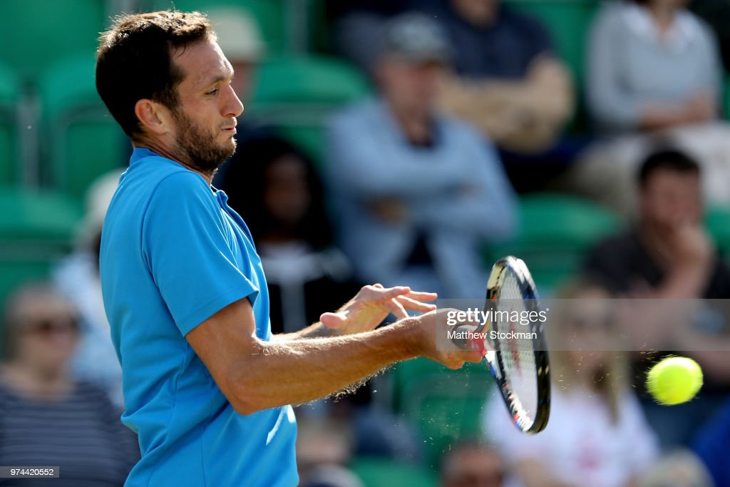 James Ward returns a shot to Marc Polmans of Australia during Day Six of the Nature Valley Open at Nottingham Tennis Centre on June 14, 2018 in Nottingham, United Kingdom.