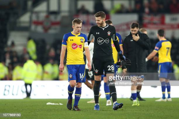 James WardProwse and Angus Gunn of Southampton at full time of the FA Cup Third Round match between Derby County and Southampton FC at Pride Park on...