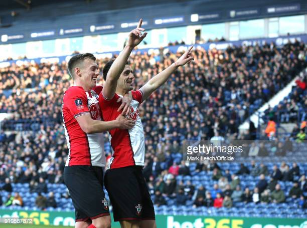 James WardProwse celebrates the second Southampton goal with scorer Dusan Tadic during the FA Cup Fifth Round match between West Bromwich Albion and...