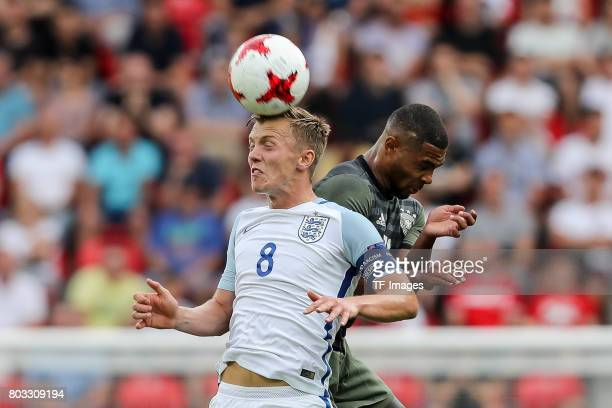 James WardProwse of England and Serge Gnabry of Germany battle for the ball during the UEFA European Under21 Championship Semi Final match between...