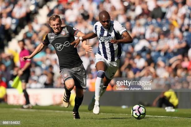 James WardProwse of Southampton and AllanRomeo Nyom of West Bromwich Albion during the Premier League match between West Bromwich Albion and...