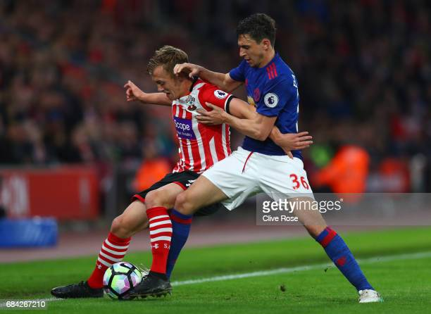 James WardProwse of Southampton and Matteo Darmian of Manchester United battle for possession during the Premier League match between Southampton and...