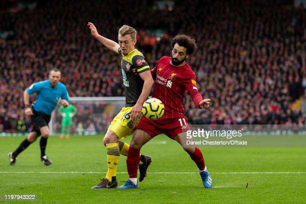 James Ward-Prowse of Southampton and Mohamed Salah of Liverpool during the Premier League match between Liverpool FC and Southampton FC at Anfield on...