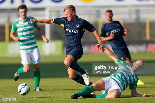 James WardProwse of Southampton avoids the tackle of David Vandecauter of KSK Hasselt during the preseason friendly match between KSK Hasselt and...