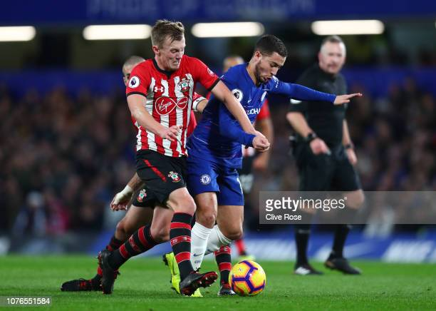 James WardProwse of Southampton battles for possession with Eden Hazard of Chelsea during the Premier League match between Chelsea FC and Southampton...