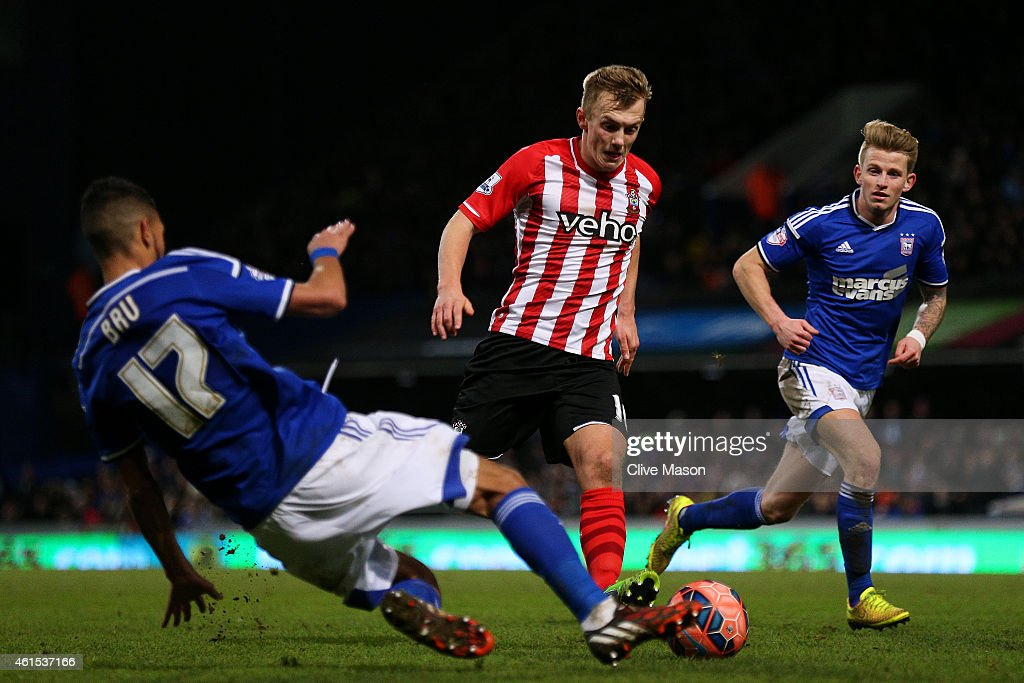 James Ward-Prowse of Southampton battles for the ball with Kevin Bru of Ipswich during the FA Cup third round replay match between Ipswich Town and Southampton at Portman Road on January 14, 2015 in Ipswich, England.