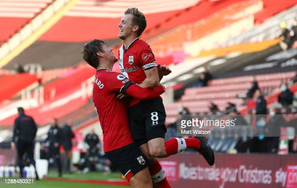 James Ward-Prowse of Southampton celebrates with Jannik Vestergaard during the Premier League match between Southampton and Manchester United at St...