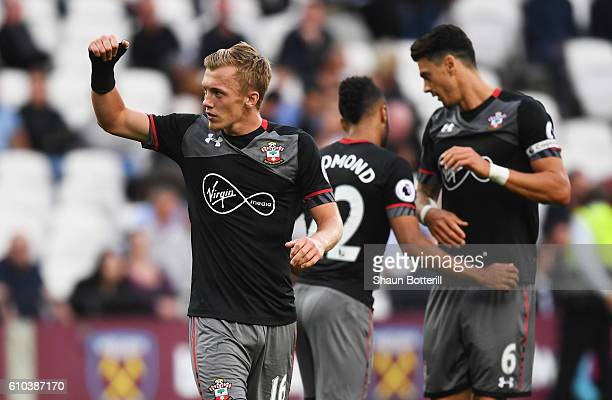 James WardProwse of Southampton celebrates with team mates as he scores their third goal during the Premier League match between West Ham United and...