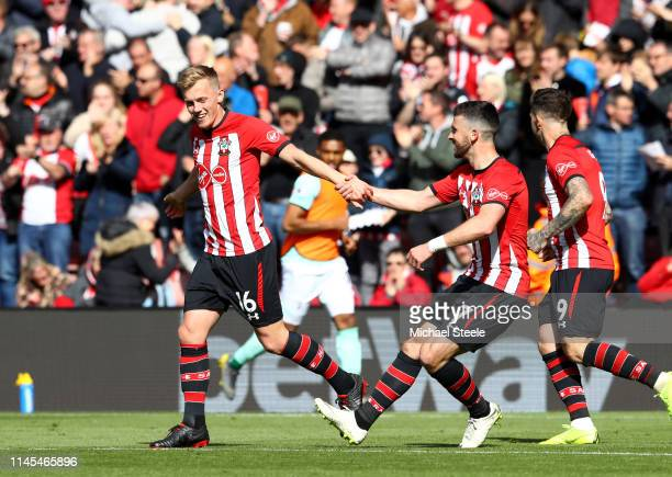 James WardProwse of Southampton celebrates with teammate Shane Long after scoring his team's second goal during the Premier League match between...