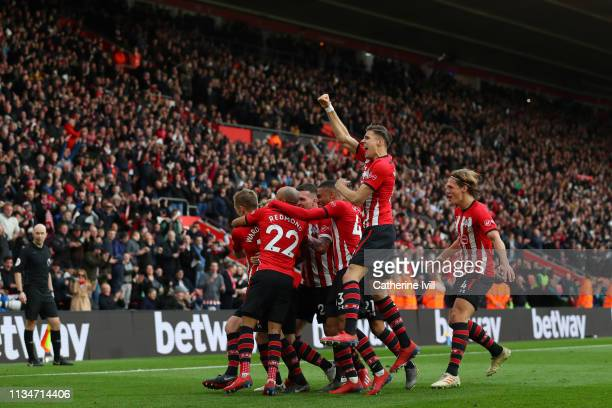 James WardProwse of Southampton celebrates with teammates after scoring his team's second goal during the Premier League match between Southampton FC...