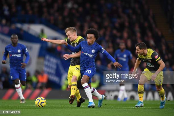 James WardProwse of Southampton challenges for the ball with Willian of Chelsea during the Premier League match between Chelsea FC and Southampton FC...