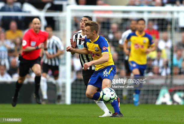 James WardProwse of Southampton fouls Miguel Almiron of Newcastle United during the Premier League match between Newcastle United and Southampton FC...