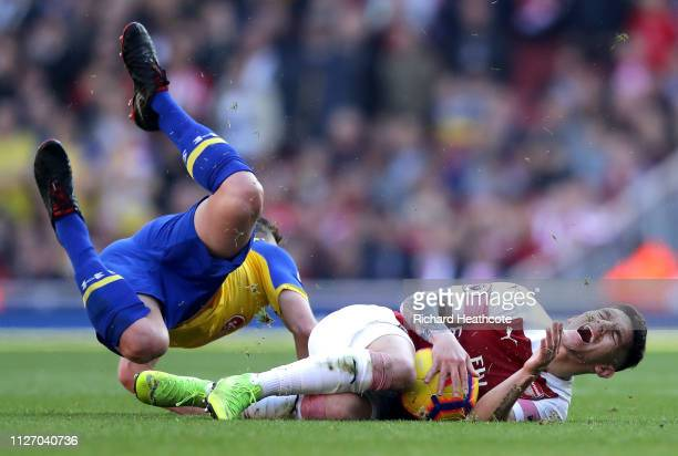 James Ward-Prowse of Southampton is challenged by Lucas Torreira of Arsenal during the Premier League match between Arsenal FC and Southampton FC at...
