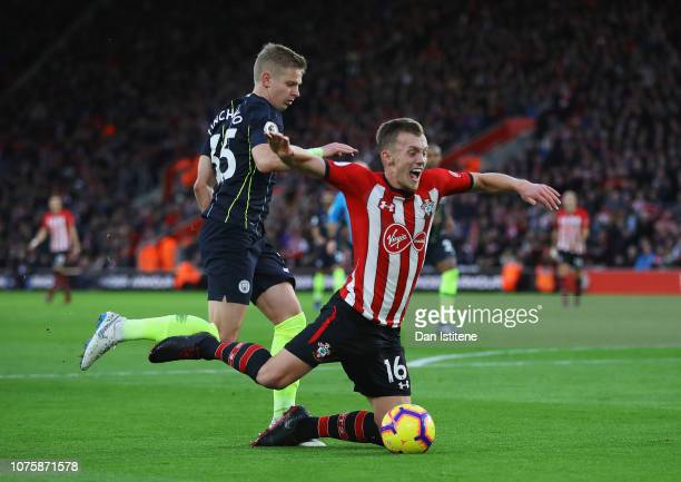 James WardProwse of Southampton is challenged by Oleksandr Zinchenko of Manchester City in the penalty area during the Premier League match between...