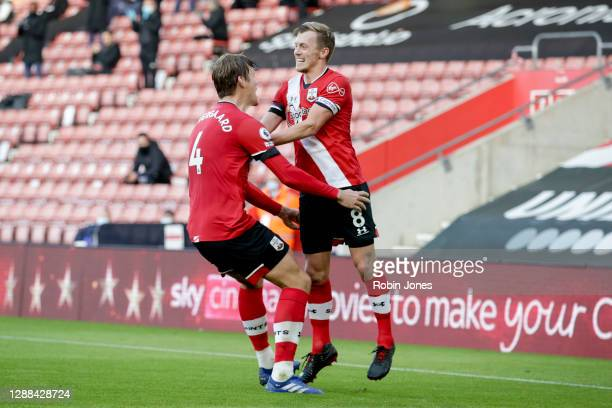 James Ward-Prowse of Southampton is congratulated by team-mate Jannik Vestergaard after he scores from a free-kick to make it 2-0 during the Premier...
