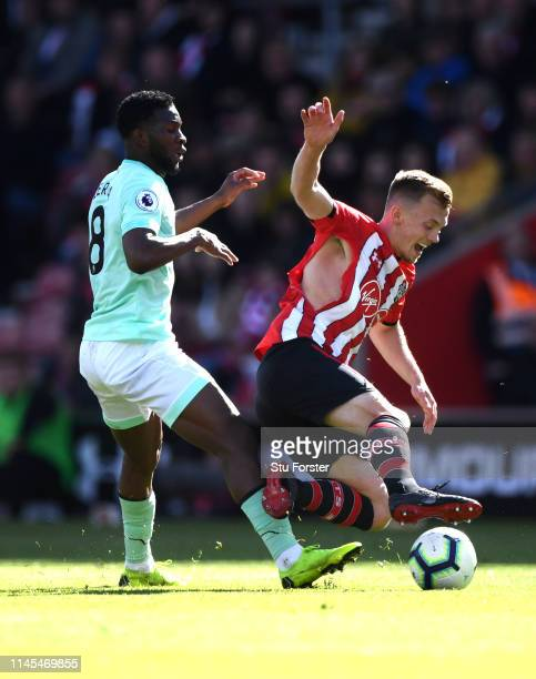 James WardProwse of Southampton is fouled by Jefferson Lerma of AFC Bournemouth and rips his shirt during the Premier League match between...