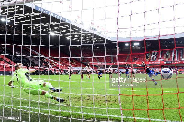 James Ward-Prowse of Southampton scores a penalty for his team's first goal past Aaron Ramsdale of Sheffield United during the Premier League match...
