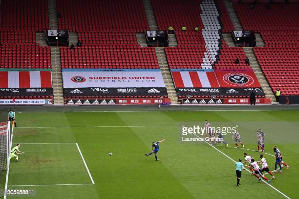 James Ward-Prowse of Southampton scores a penalty past Aaron Ramsdale of Sheffield United for his team's first goal during the Premier League match...