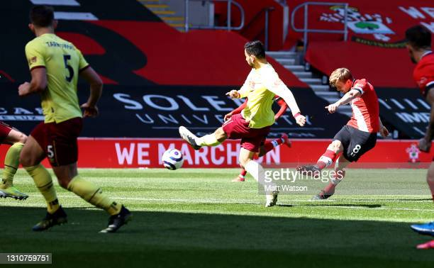 James Ward-Prowse of Southampton shoots at goal but his shot hits the bar during the Premier League match between Southampton and Burnley at St...