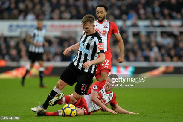 James WardProwse of Southampton tackles Matt Ritchie of Newcastle United during the Premier League match between Newcastle United and Southampton at...