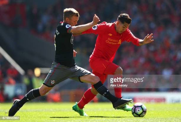 James WardProwse of Southampton tackles Roberto Firmino of Liverpool during the Premier League match between Liverpool and Southampton at Anfield on...