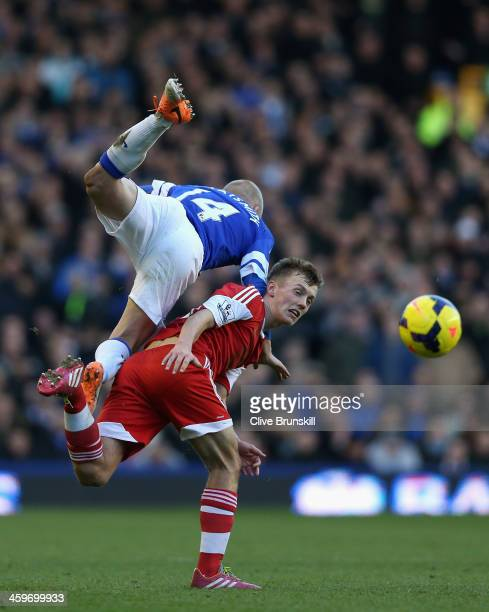 James WardProwse of Southampton tangles with Steven Naismith of Everton during the Barclays Premier League match between Everton and Southampton at...