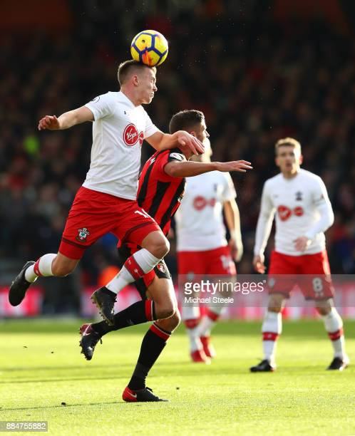 James WardProwse of Southampton wins a header over Andrew Surman of AFC Bournemouth during the Premier League match between AFC Bournemouth and...