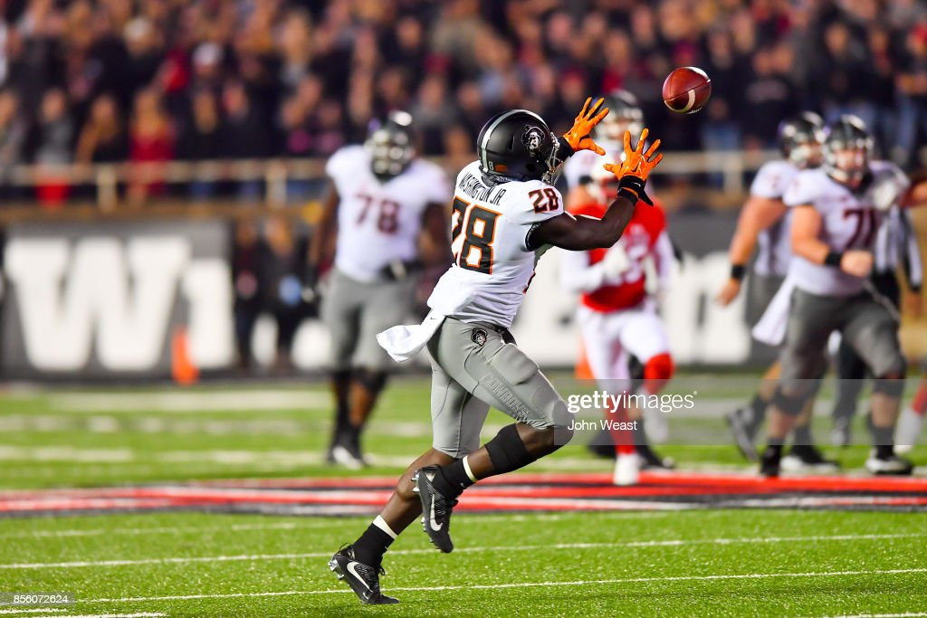 James Washington #28 of the Oklahoma State Cowboys makes the catch during the first half of the game against the Texas Tech Red Raiders on September 30, 2017 at Jones AT&T Stadium in Lubbock, Texas.