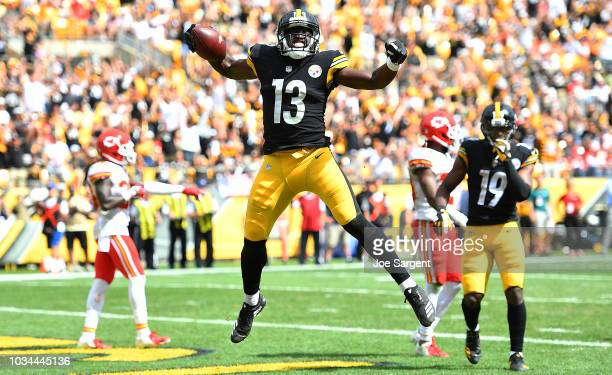 James Washington of the Pittsburgh Steelers celebrates after a 14 yard touchdown reception in the first half during the game against the Kansas City...