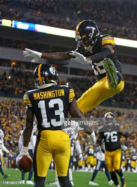James Washington of the Pittsburgh Steelers celebrates with Diontae Johnson after catching a 3 yard touchdown pass in the first half against the Los...