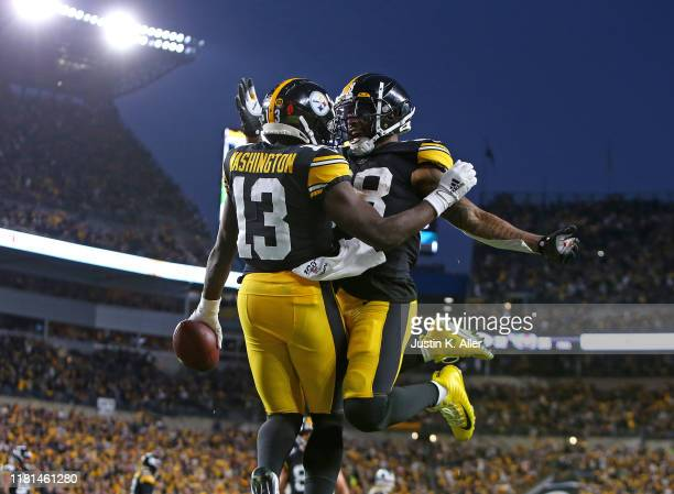 James Washington of the Pittsburgh Steelers celebrates with Jaylen Samuels after catching a 3 yard touchdown pass in the first half against the Los...