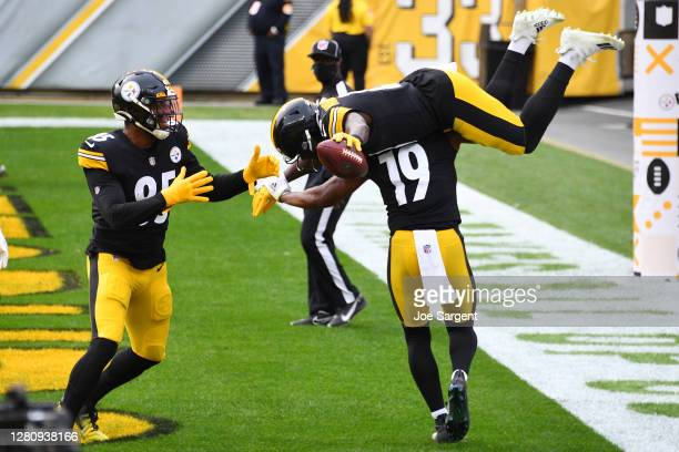 James Washington of the Pittsburgh Steelers celebrates with JuJu Smith-Schuster after a 28-yard touchdown against the Cleveland Browns during their...