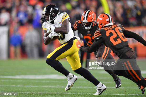 James Washington of the Pittsburgh Steelers runs away from Juston Burris of the Cleveland Browns and Greedy Williams of the Cleveland Browns after...