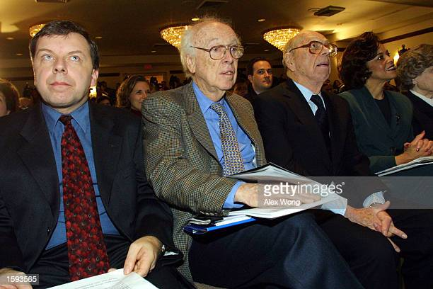 James Watson codiscoverer of the DNA helix second from left listens February 12 2001 in Washington D C during a press conference on the first...
