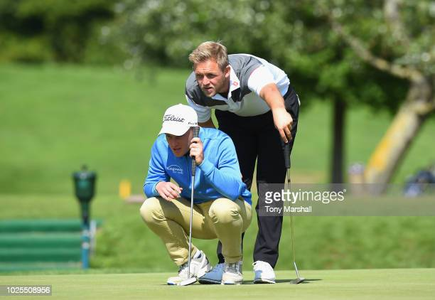 James Watts of Kingsway Golf Centre and Jack Winer of Abridge Golf Country Club line up a putt on the 9th green during the final round of the...