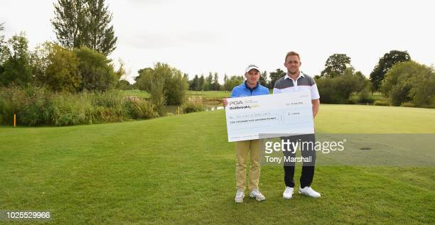 James Watts of Kingsway Golf Centre and Jack Winer of Abridge Golf Country Club pose with a cheque for winning the Golfbreakscom PGA Fourball...