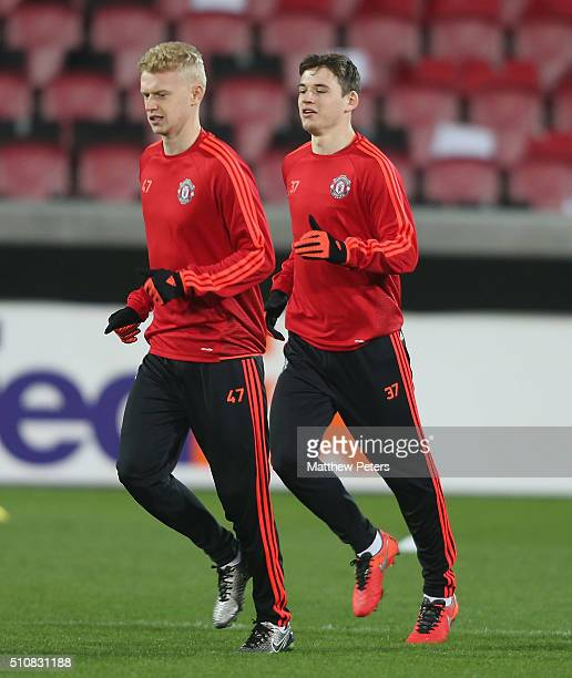 James Weir and Donald Love of Manchester United in action during a first team training session ahead of their UEFA Europa League match against FC...
