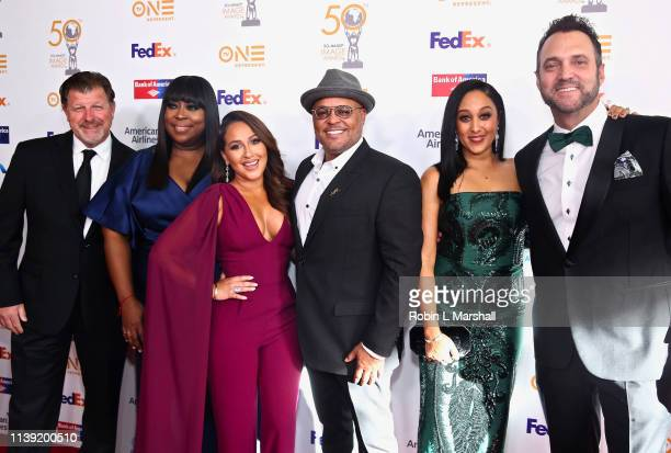 James Welsh Loni Love Adrienne Bailon Israel Houghton Tamera Mowry and Adam Housley attend the 50th NAACP Image Awards Dinner at The Beverly Hilton...