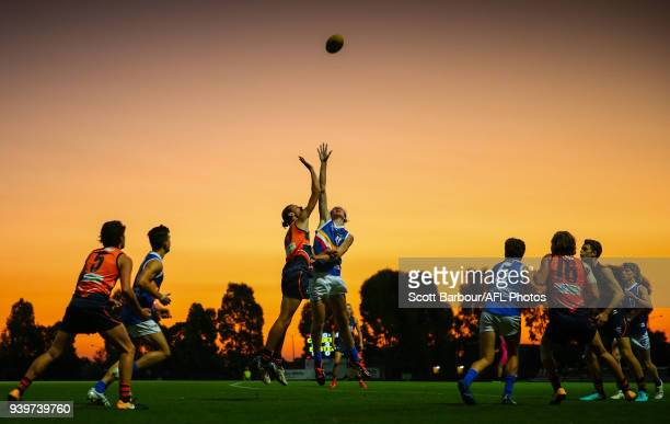 James Westphal of the Calder Cannons and Jas Corless of the Eastern Ranges compete for the ball during the round two TAC Cup match between Calder and...