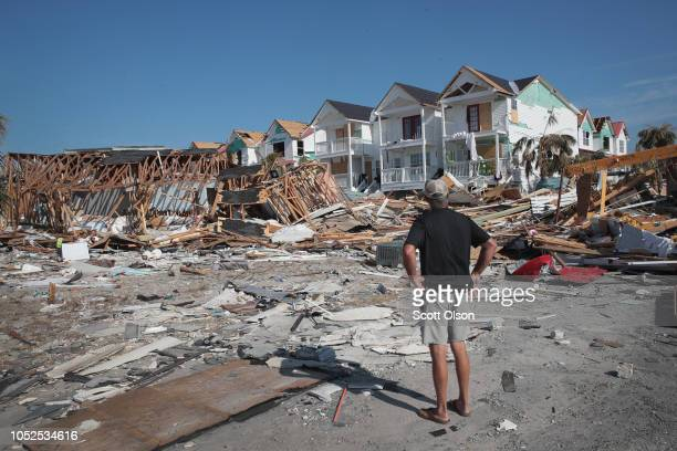 James Whiddon looks over damage caused by Hurricane Michael on October 19 2018 in Mexico Beach Florida Hurricane Michael slammed into the Florida...